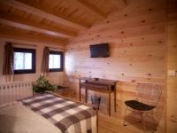 Habitació de matrimoni Sur a Masia Spa Can Pascol.